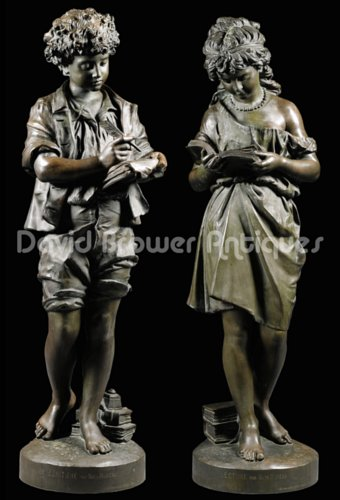 Pair of larger than life figures entitled Ecriture & Lecture by Mathurin Moreau