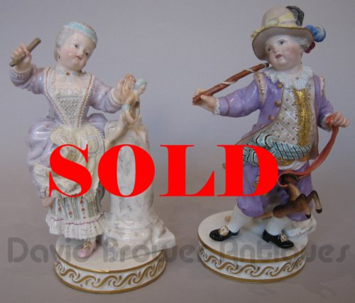 Pair of Meissen Figures, girl with a doll and boy with hobby horse