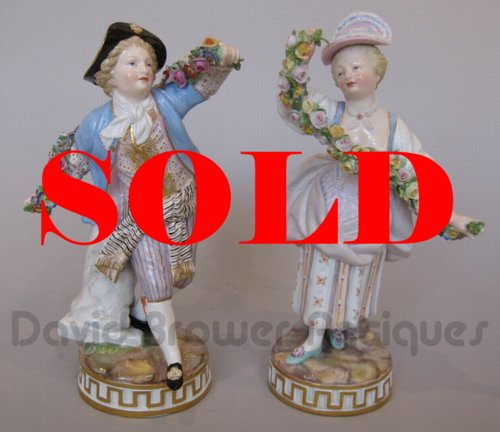 Pair of Meissen figures of a gallant and companion with floral garlands