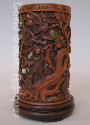 Japanese wooden brushpot decorated in monkeys and foliage