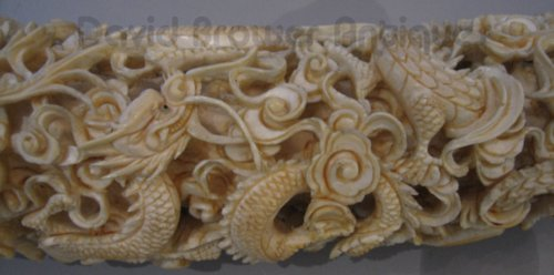 A Chinese ivory carved tusk on stand